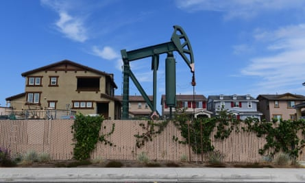 A pumpjack near homes in residential Signal Hill, California.