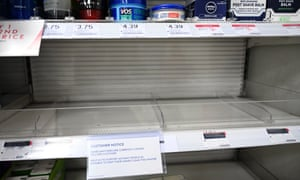 Empty shelf in pharmacy with sign saying hand sanitisers limited to two per customer