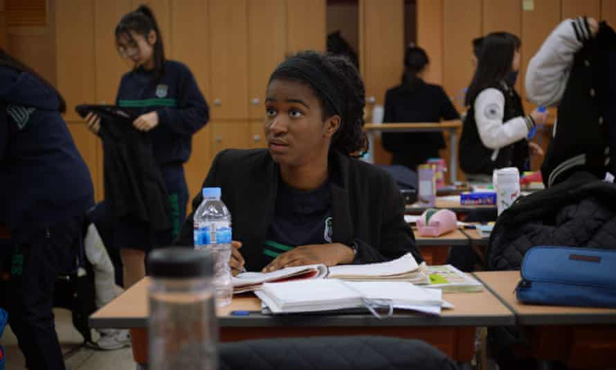 Simone studying at her high school in South Korea.