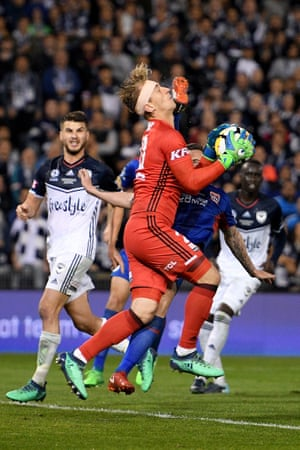 Lawrence Thomas of Victory receives a boot to the face from Roy O Donovan of the Jets during the A-League Grand Final.