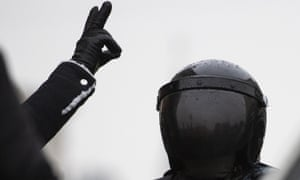 A man gestures as police officer, right, guards during a protest against the jailing of opposition leader Alexei Navalny in Moscow, Russia, Saturday, Jan. 23, 2021. Russian police on Saturday arrested hundreds of protesters who took to the streets in temperatures as low as minus-50 C (minus-58 F) to demand the release of Alexei Navalny, the country's top opposition figure. (AP Photo/Pavel Golovkin)