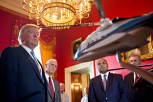 Donald Trump and Mike Pence look at a Sikorsky Aircraft Corp. model