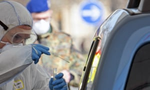 A member of the German armed forces helps out at a mobile coronavirus testing station.