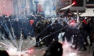 Riot police clash with protesters at a demonstration against pension reforms in Paris last week.