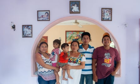 Luis Góngora's widow stands with their daughter, two sons and grandchildren at their home in Teabo.