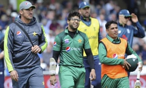 Pakistan's Iman-ul Haq grimaces in pain as he leaves the pitch.