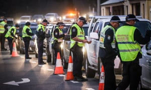 Police stop and question drivers at a checkpoint on the border between Victoria and NSW.
