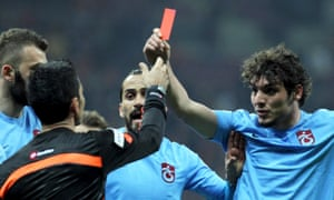 Salih Dursun shows a red card to referee Deniz Ates Bitnel during the match between Galatasaray and Trabzonspor. He was sent off for his actions.
