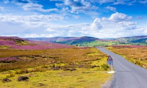 Road winding across Grinton Moor, North Yorkshire.