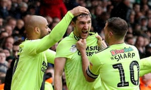 David McGoldrick and Billy Sharp congratulate Chris Basham on scoring what proved to be Sheffield United's winner against Leeds at Elland Road