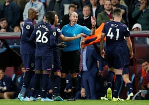 West Ham United players protest as Arthur Masuaku is sent off by referee Mike Dean.