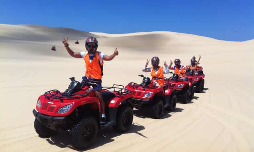 Tourists on a sand dune adventure on land owned by an Aboriginal Land Council, with a company also owned by the land council.