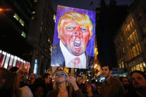 A woman holds a poster as she takes part in a protest in New York