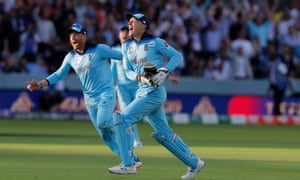 Jos Buttler wheels away in celebration after running out Martin Guptill in the deciding super over