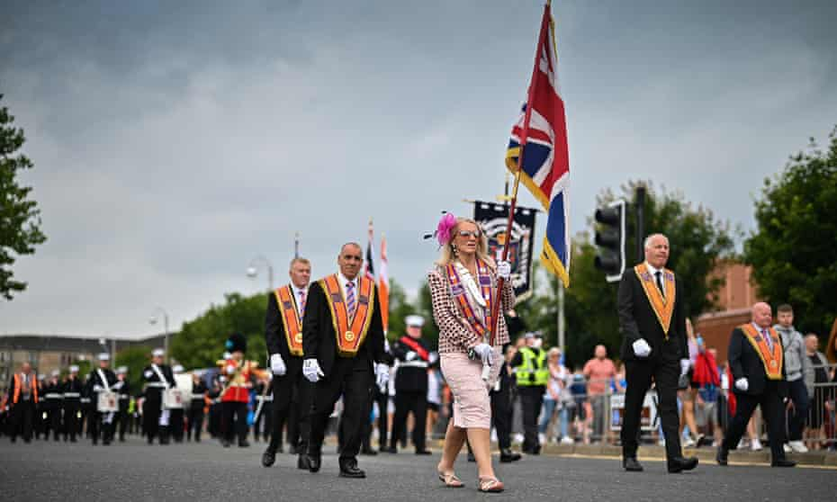 Members of the Loyal Orange Institution Govan District 42 marching in Glasgow in July. More than 30 parades are expected to converge on Saturday.