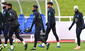 Joe Gomez, second left, and Raheem Sterling, right, in training on Tuesday.