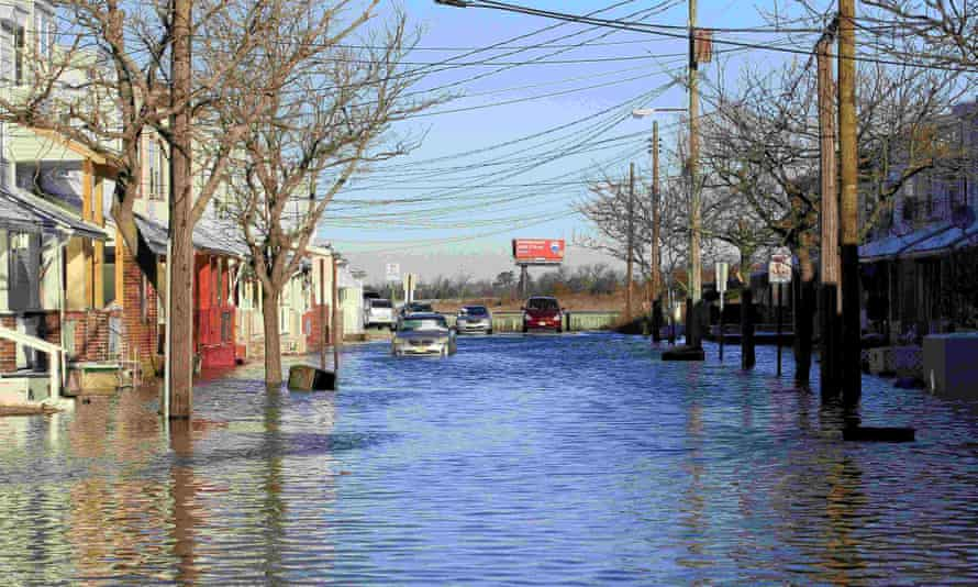Arizona Avenue is seen underwater following coastal flooding in Atlantic City, New Jersey, on 24 January 2016. More than 13 million Americans are at risk with a 6ft (1.8 meter) rise in sea level, scientists say.