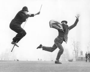 A policeman on a pogo stick chases a criminal who is carrying a bag of loot