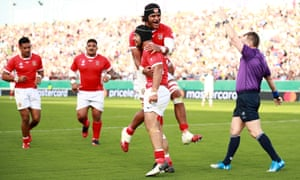 Malietoa Hingano celebrates with his Tonga teammates.