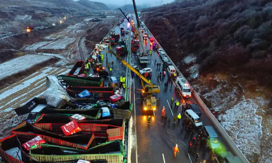 Cranes work to clear the Kunming expressway.