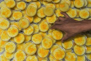 A man arranges sweet plates for devotees to break their fast in Kathmandu
