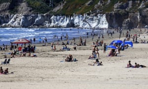 People gather in Pismo Beach, California, on 25 April.