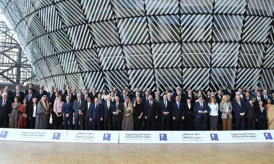 Participants pose during the conference in Brussels on 25 April.