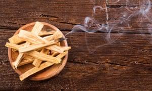 Smoking holy or sacred wood palo santo (Bursera graveolens)
