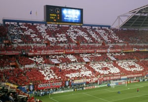 South Korean fans hold white cards to spell out 'AGAIN 1966' prior to a second round World Cup Finals match against Italy in June 2002.