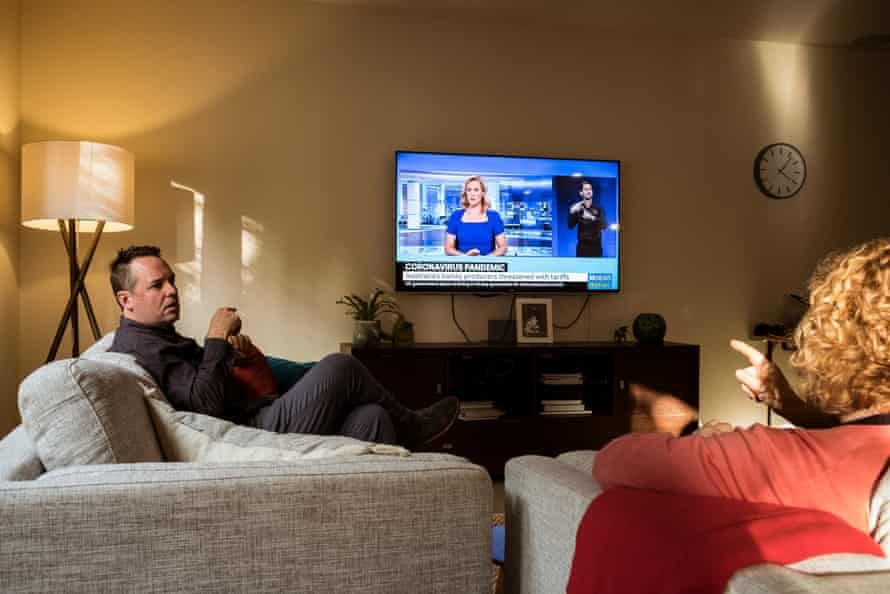 Gavin and Trisha Balharrie discuss news on the coronavirus using sign language and the assistance of an on-screen Auslan translator onscreen.