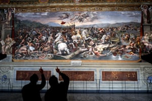 Rome, ItalyVisitors admire a Raphael Room inside the Vatican as it reopens today