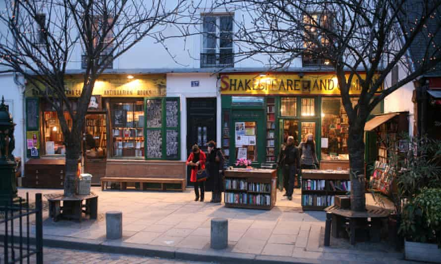 Customers outside the Shakespeare and Company bookshop, Paris, France. for Saturday Review.