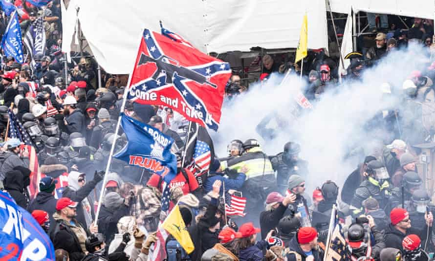 Smoke from pepper-spray ball exploded and used against pro-Trump protesters during the storm of Capital building on 6 January.