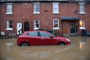 Shrewsbury: Floodwaters surround a car parked outside a row of houses in the west of England after Storm Christoph brought heavy rains across the country.