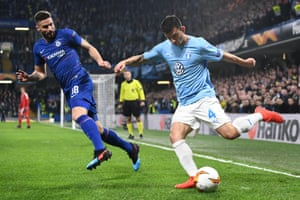 Behrang Safari of Malmo clears under pressure from Olivier Giroud of Chelsea.