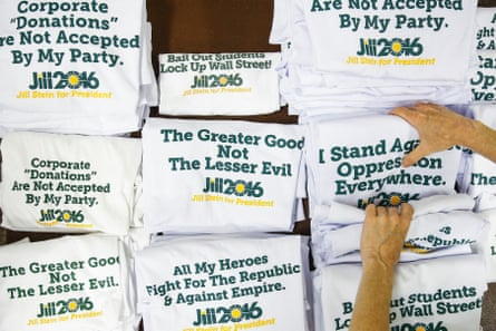 A Green party volunteer folds Jill Stein shirts as people arrive for the convention at the University of Houston.