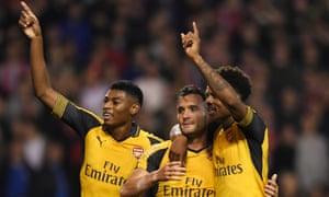 Arsenal's Lucas Perez, centre, celebrates scoring their third goal with Jeff Reine-Adelaide, left, and Chuba Akpom.
