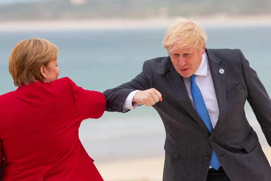 Boris Johnson greets German chancellor Angela Merkel with an elbow bump.