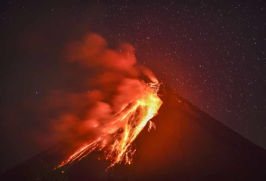 Lava flows down the slope of Mount Mayon as seen from Legazpi in Albay province
