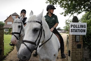 Horses Splash and Sharna, ride out of the driveway of a private residence, used as a polling station, near Reading