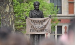 A statue of suffragist and women's rights campaigner Millicent Fawcett by British artist Gillian Wearing is unveiled in Parliament Square in London, 14 April 2018.