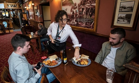 Customers at a Wetherspoons pub in Colindale, London