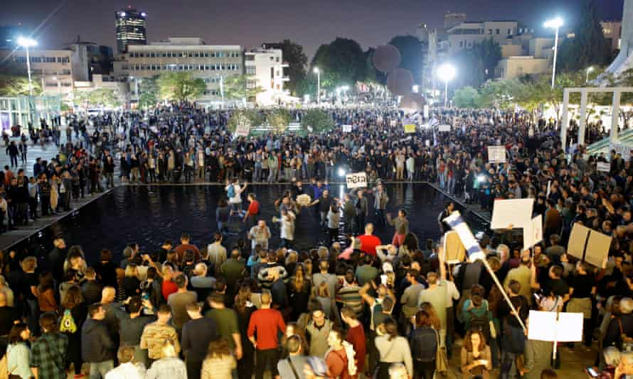 Israelis take part in a protest against corruption in Tel Aviv.