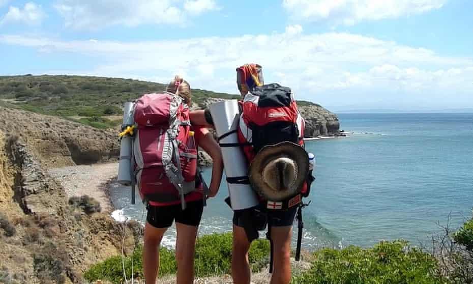 two hikers on coastal path