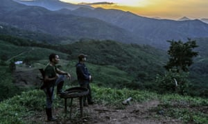 FARC guerillas on guard during the days prior to their mobilization to the final concentration zones in Colombia, where they will give up their weapons