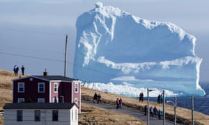 Residents view the first iceberg of the season as it passes the South Shore of Newfoundland in 2017.