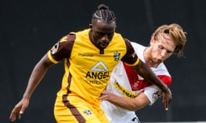 Sutton's Tom Bolarinwa, left, battles with Scott Stewart of Airdrieonians in September's Scottish Challenge Cup meeting, which the English side won 1-0.