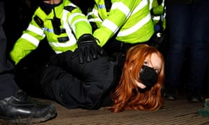 A woman is arrested at Clapham Common vigil.