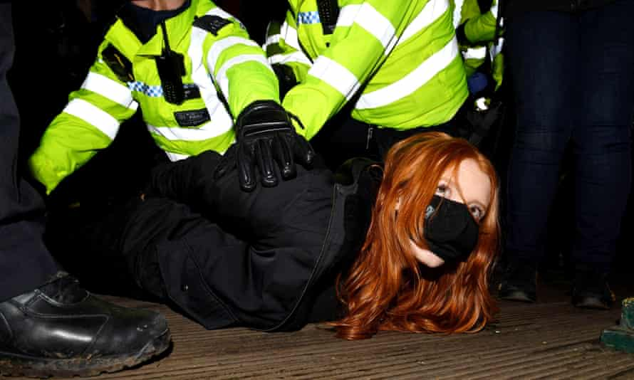 A woman is arrested on the bandstand on Clapham Common.