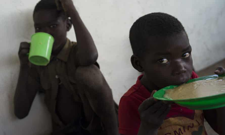 Children from South Sudan consume porridge supplied by the World Food Programme at the Imvepi settlement in February 2017